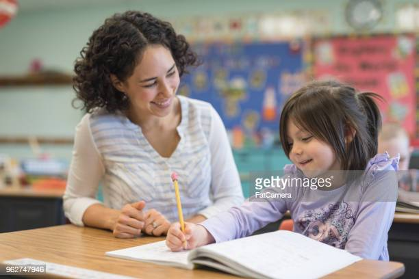 elementary school classroom - teacher stock pictures, royalty-free photos & images
