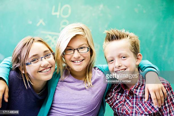 elementary school friends - brace stock pictures, royalty-free photos & images
