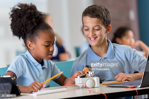 Elementary school friends work on technology assignment