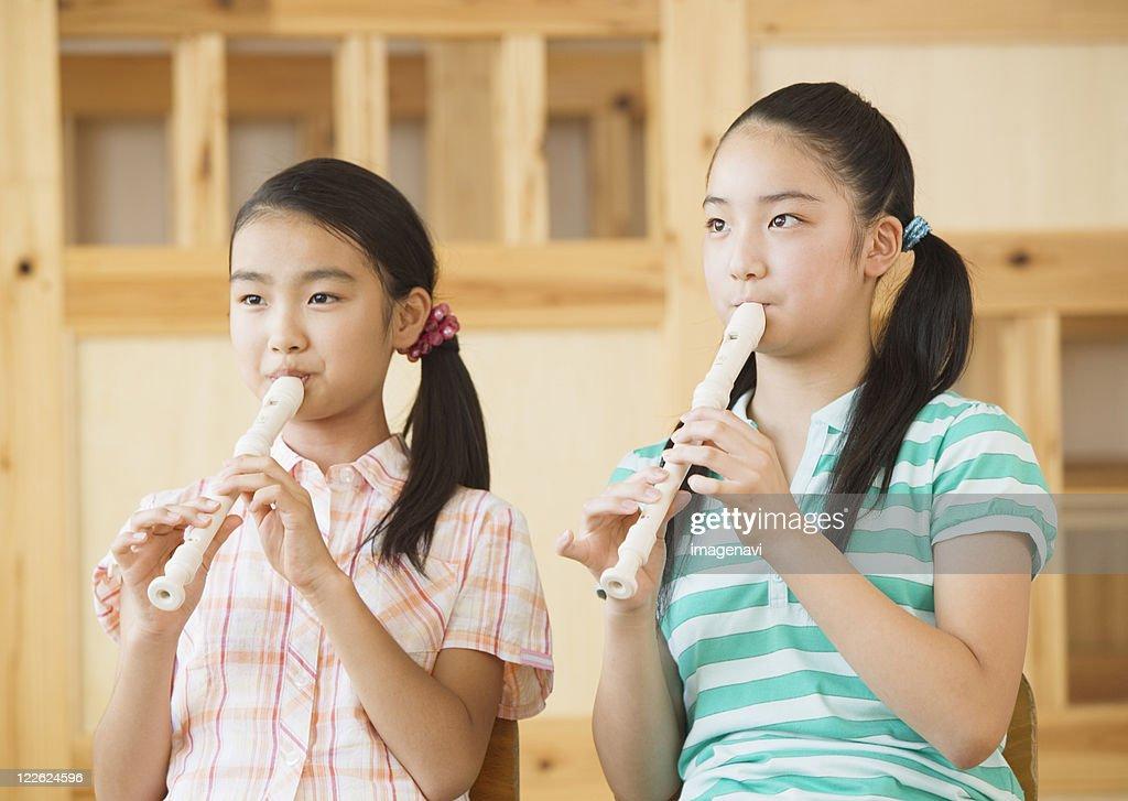 Elementary school girls playing recorders : ストックフォト