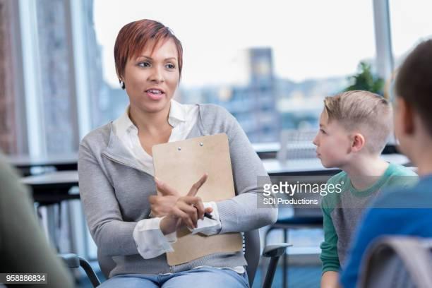 elementary school principal disciplines students - school principal stock pictures, royalty-free photos & images