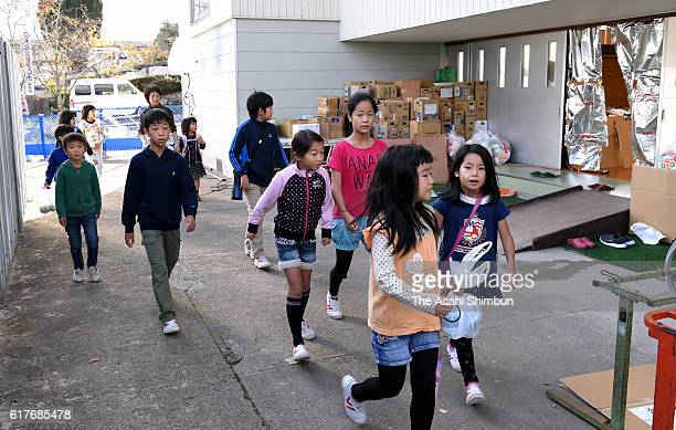 Elementary school pupils commute as schools resume after the magnitude 66 earthquake hit the area three days ago on October 24 2016 in Kurayoshi...