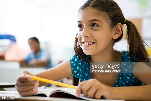 elementary school student in class - primary school child stock pictures, royalty-free photos & images