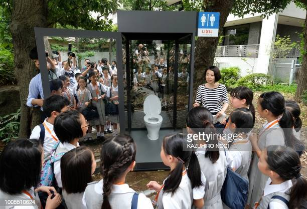 Elementary school students look at a public toilet on display with oneway glass during a special interactive class with students about sanitation in...