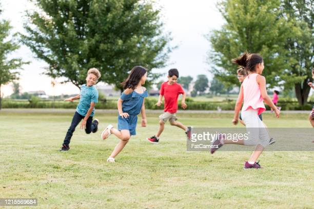 elementary school students play at recess stock photo - messing about stock pictures, royalty-free photos & images