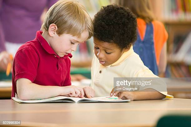 Elementary School Students Reading Together