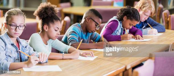 elementary school students taking a test - elementary school stock pictures, royalty-free photos & images