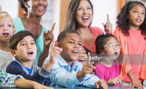 Elementary school students, teachers in classroom