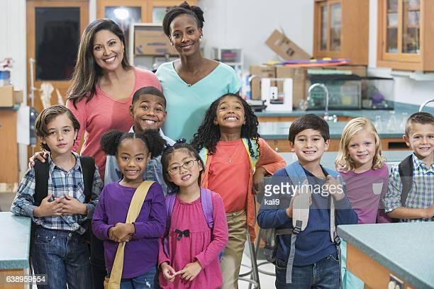 Elementary school students, teachers in science lab