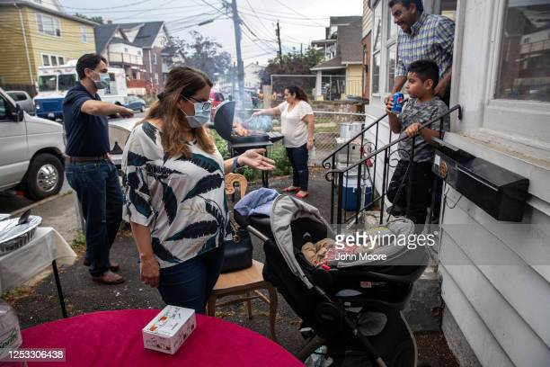Elementary school teacher Luciana Lira greets baby Neysel 10 weeks at a dinner celebrating his three month birthday on June 28 2020 in Stamford...