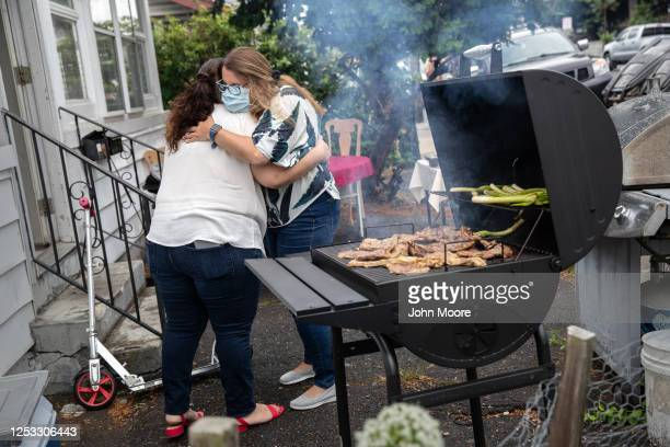 Elementary school teacher Luciana Lira greets Zully after arriving for a dinner celebrating Zully' baby Neysel's three month birthday on June 28 2020...