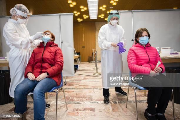 Elementary school teachers take a rapid COVID-19 antigen test before schools reopen in Slovenia. Elementary School teachers take mass rapid COVID-19...