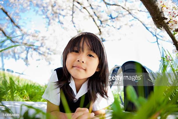 Elementary schoolchild under the cherry tree