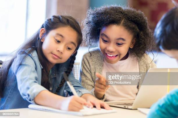 elementary schoolgirls brainstorm ideas - science photo library stock pictures, royalty-free photos & images