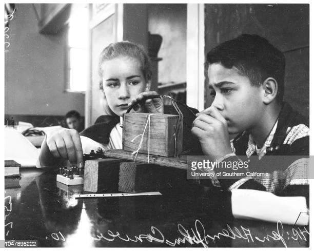 Elementary scientists 7 February 1958 Jan Allen 11 years John Converse 10 yearsRandy Lund 11 yearsCandy Hershman 11 yearsCaption slip reads...