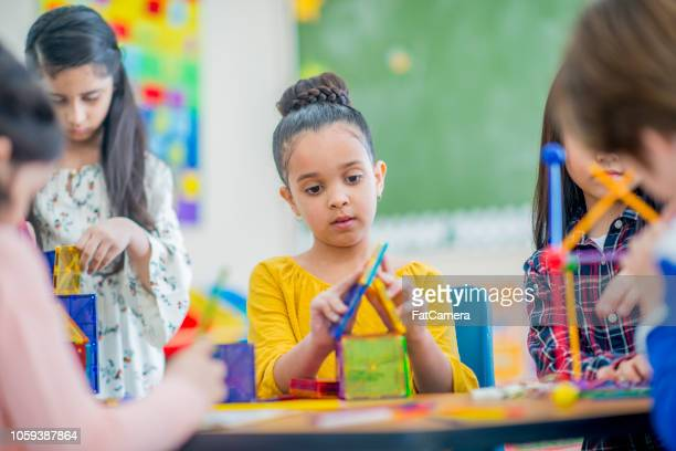 elementary student constructing a colorful house - state school stock pictures, royalty-free photos & images