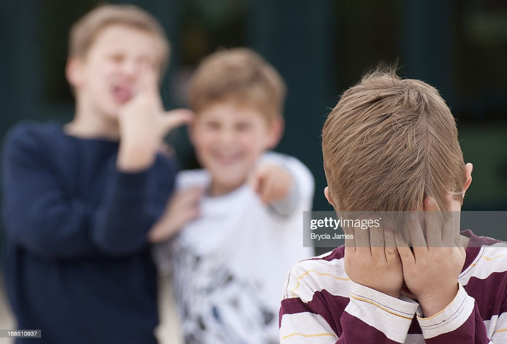 Elementary Student Hides His Face While Being Bullied : Stock Photo