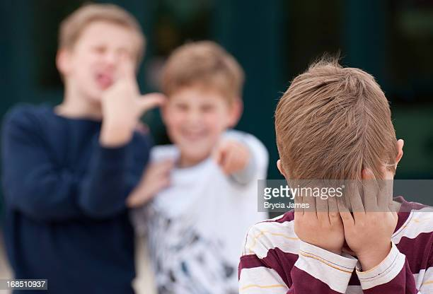 Elementary Student Hides His Face While Being Bullied