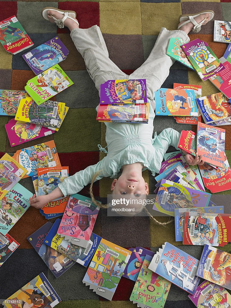 Elementary Student Reading in Library : Stock Photo