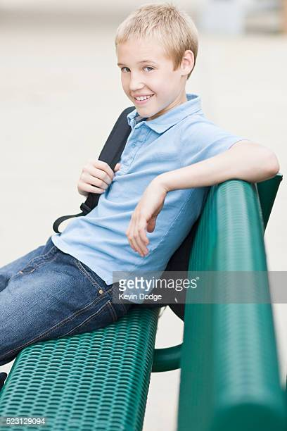 Elementary Student Sitting on Bench