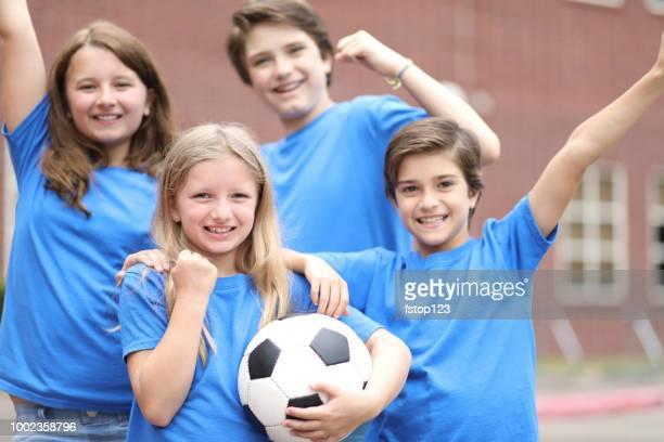 Elementary student soccer team celebrates win.