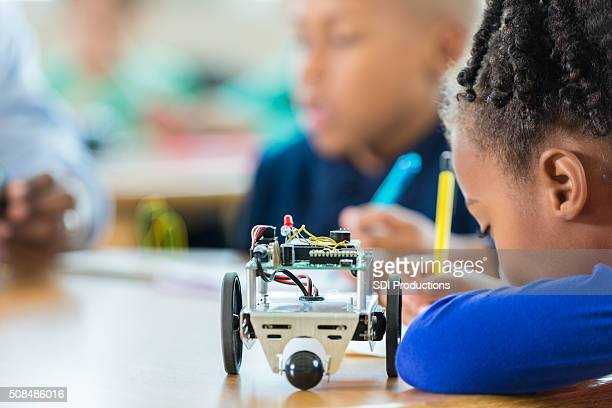 Elementary student using robotics kit in science class
