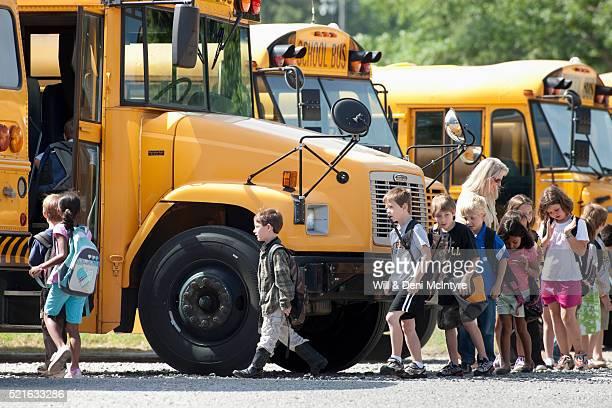 Elementary students boarding school bus