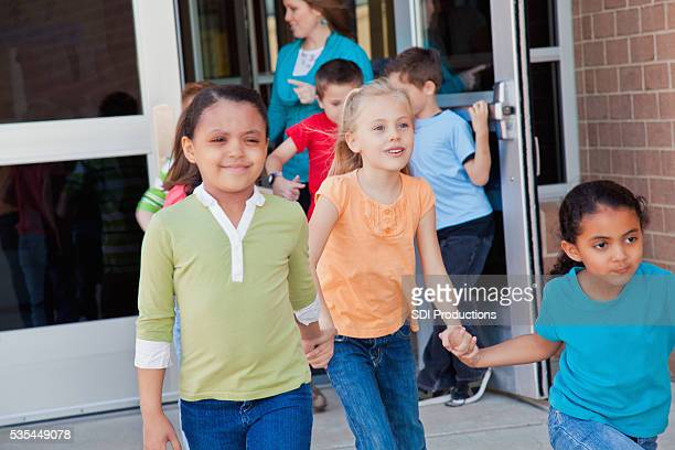 Elementary students going to recess