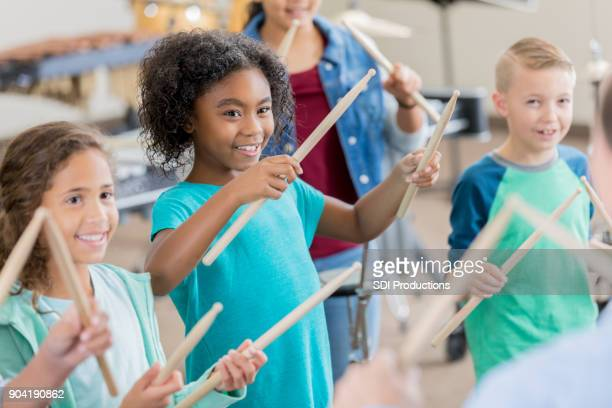 elementary students learn to play percussion instruments - percussion instrument stock photos and pictures