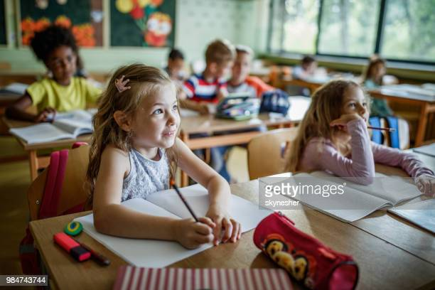 elementary students paying attention during a class in the classroom. - classroom stock pictures, royalty-free photos & images
