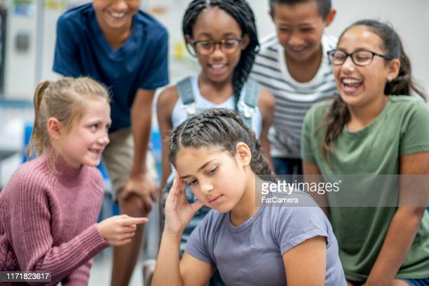 elementary students - teasing stock pictures, royalty-free photos & images