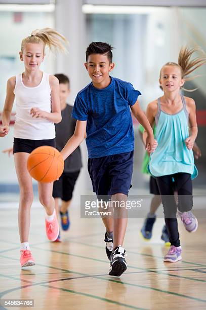 Elementary Students Playing Basketball
