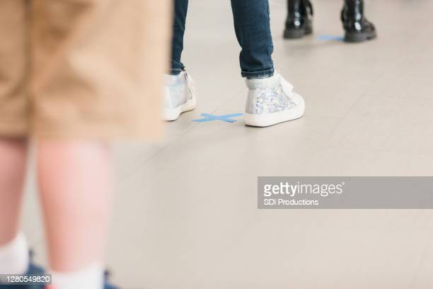 elementary students practicing social distancing - school girl shoes stock pictures, royalty-free photos & images