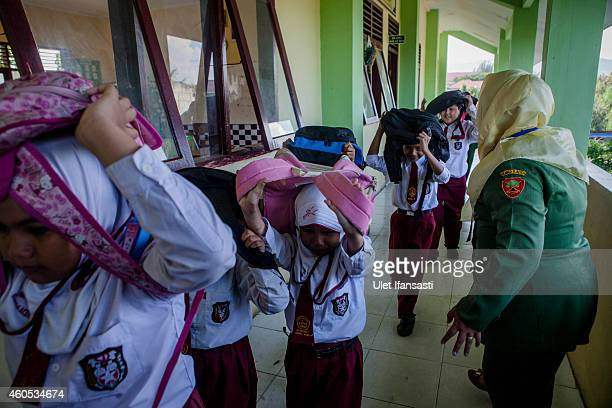 Elementary students ran out of their class as they perform earthquake and tsunami simulation on December 15 2014 in Banda Aceh Indonesia Aceh was the...