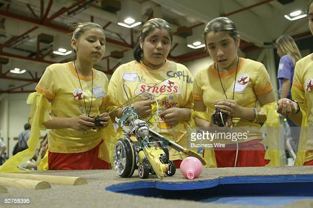 Elementary students Sandy Thelles Maria Nurlez and Jessica Nurlez from downtown San Jose's Third Street Community Center designed and operated a...