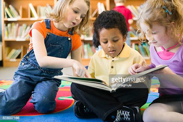 Elementary Students Sharing Book