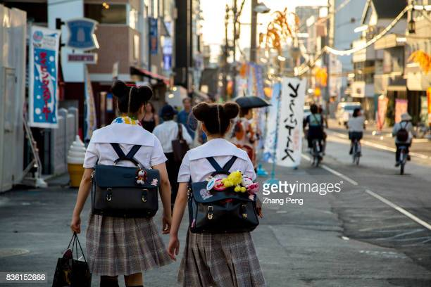 Elementary students walk on the street after school By 2060 Japan's population will fall to 80 million which means 1 million decrease per year on...