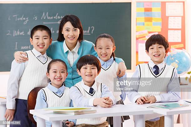 Elementary students with teacher in class