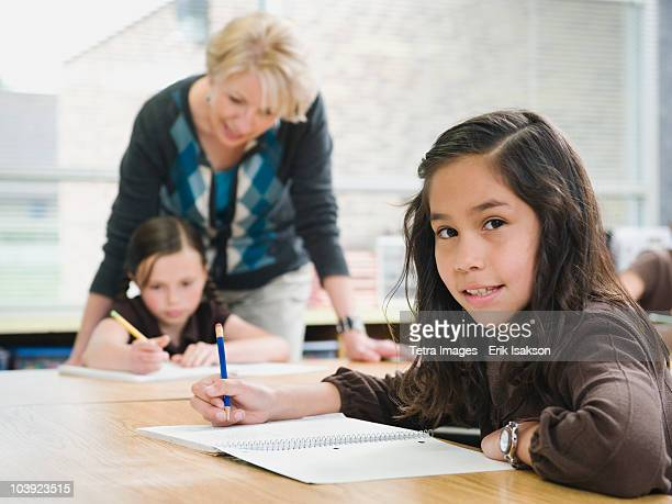 Elementary students writing in their notebooks