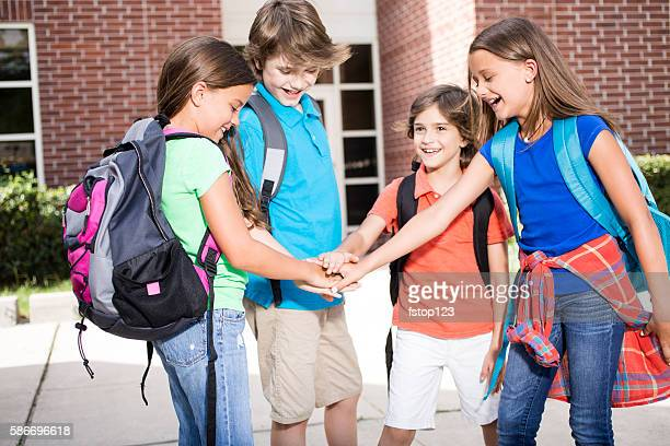 Elementary-age children, friends on campus go back to school.