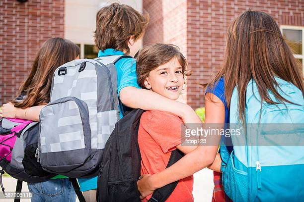 Elementary-age children going back to school.
