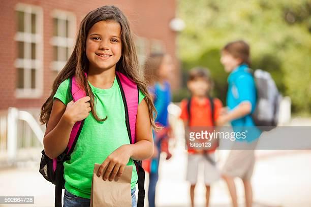 Elementary-age children on school campus.