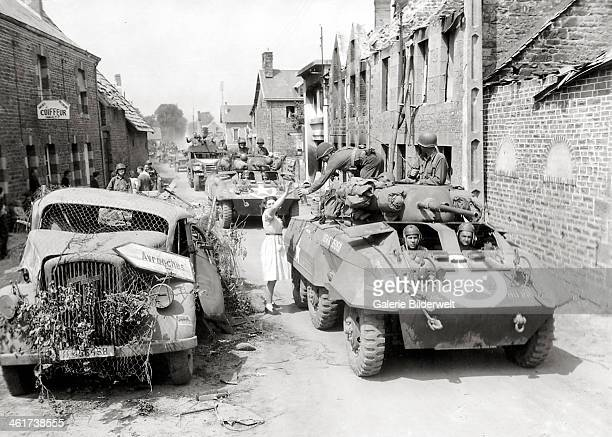 Elements of the 25th Cavalry Reconnaissance Squadron of the 4th Armored Division are having lunch near the intersection of D35 and D924 about 14 km...