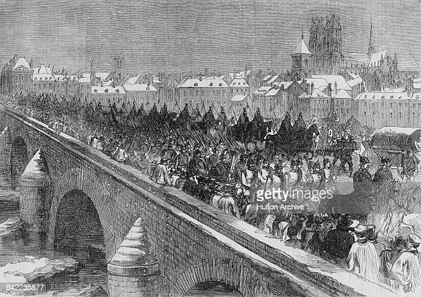 Elements of the Prussian army crossing the George V bridge over the Loire with the Cathedral of the Holy Cross in the background at Orleans during...