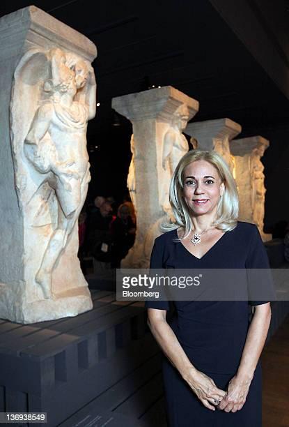 Elena Ambrosiadou cofounder of IKOS Asset Management Ltd poses for a photograph standing next to the original Greek statues known as Las Incantadas'...