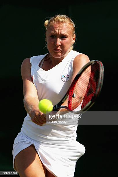 Elena Baltacha of Great Britain plays a backhand during the women's singles second round match against Kirsten Flipkens of Belgium on Day Four of the...