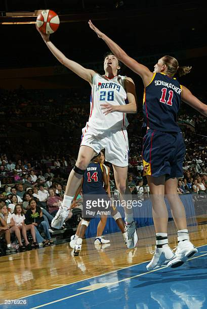 Elena Baranova of the New York Liberty puts up shot against Kelly Schumacher of the Indiana fever during the WNBA game at Madison Square Garden on...