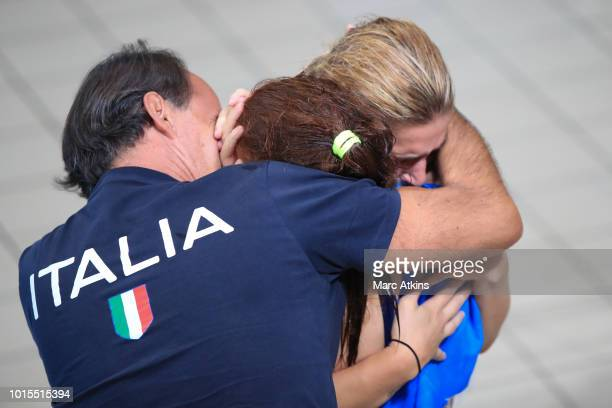 Elena Bertocchi and Chiara Pellacani of Italy react with their coach after winning Gold during the Women's 3m Synchronised Springboard Final during...