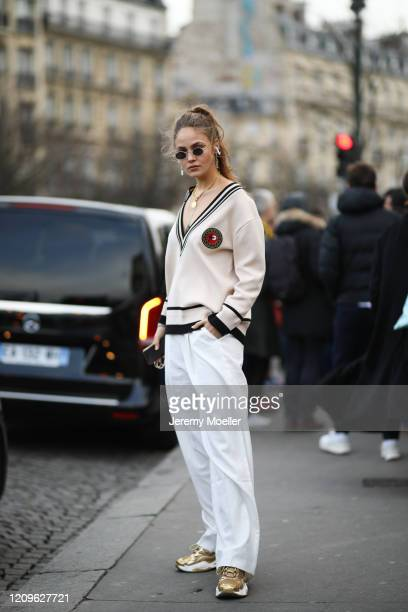 Elena Carrière is seen wearing a beige poncho and gold sneaker outside Haider Ackermann show during Paris Fashion week Womenswear Fall/Winter...