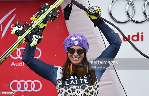 Elena Curtoni of Italy celebrates after the Audi FIS Alpine Skiing World Cup Women's Downhill Race on March 16 2016 in St Moritz Switzerland